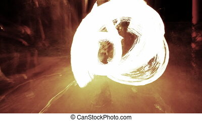abstract pattern made form images of a girl playing fire poi
