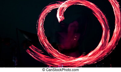man at festival playing with fire sticks