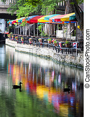 San Antonio Riverwalk - Festive colored umbrellas and...