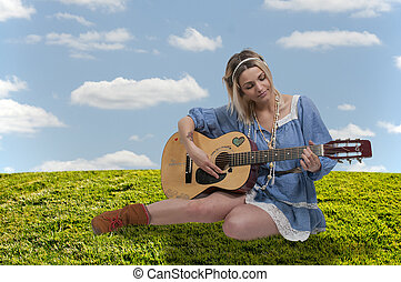 Woman with Guitar - Beautiful young woman playing an...