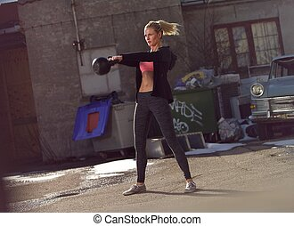 Having Toned Body Requires Hard Work - Young fitness woman...