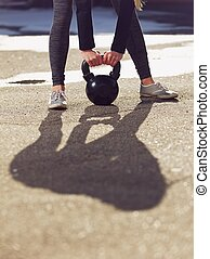 Kettlebell Being Lifted by Fitness Woman