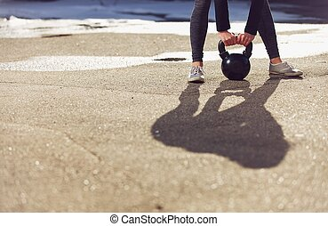 Shadow of a trainer lifting kettlebell - Shadow of a fitness...