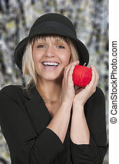 Red Delicious Apple - Beautiful woman holding a whole red...