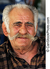 Senior Greek man with a big mustache - Portrait image of a...