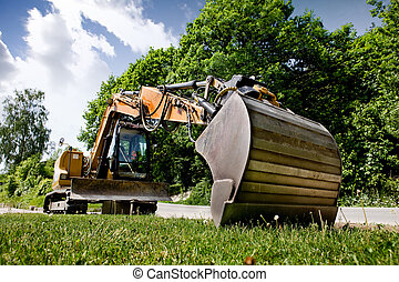 Backhoe - A backhoe sitting on grass