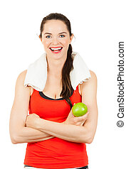 Young happy woman holding apple - Young happy fit woman...