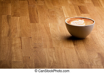 Coffee - A warm specialty coffe on a wood table