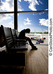 Airport Wait Transfer - A male waiting sleeping in the...