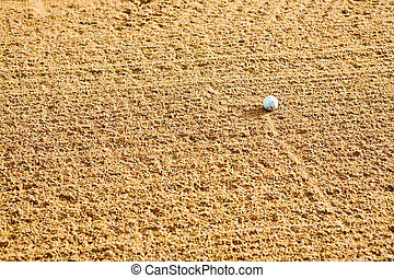 Golf Sand Trap - A golf ball in a sand trap