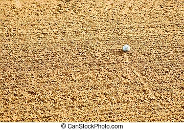 Golf Sand Trap - A golf ball in a sand trap