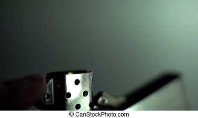 A metal lighter being ignited and its flame shot in super...
