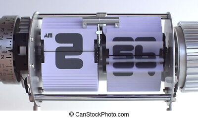 stop motion of a flip clock shot in super slow motion with...
