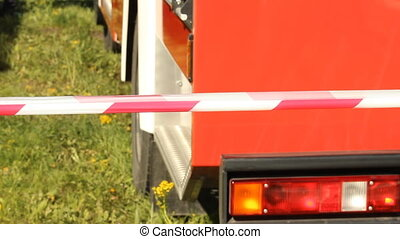 Warning tape fencing against fire engine
