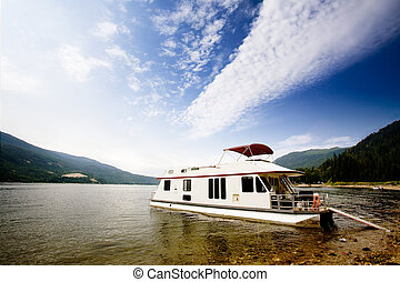 Luxury House Boat - A house boat on a lake on a beautiful...