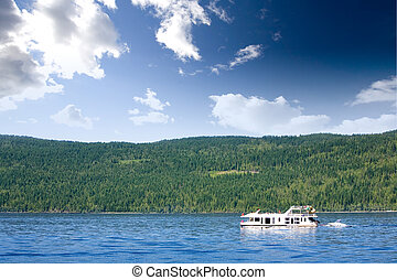 Luxury House Boat - A luxury house boat on a lake in the...