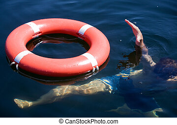 Person Drowning - A person in a large body of water drowning