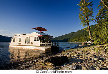 Luxury House Boat - A luxury house boat beached on a...