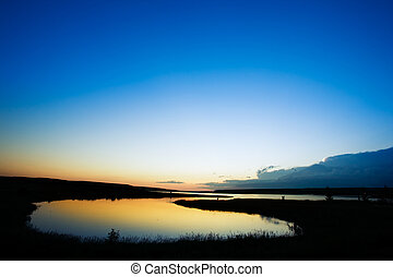 Lake Sunset - A sunset on a lake in rural saskatchewan