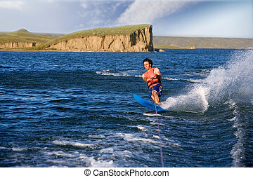 Water Skier - A man water skiing on a lake