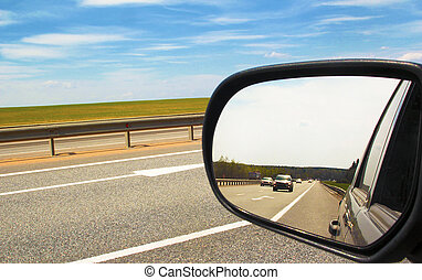 Mirror - Reflection of the movement of vehicles in the...
