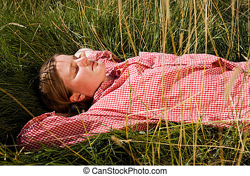 Farm Girl - A farm girl relaxing in the grass