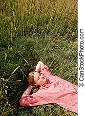 Farm Girl - A country farm girl relaxing in the grass