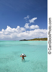 Girl in the turqouise water of Atlantic. Exuma, Bahamas