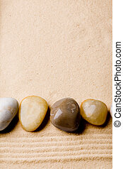 Rock on Sand Beach - A sand beach abstract background with...