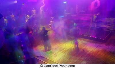 large crowd filling up the dancefloor and dancing at london...