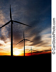 Wind Power - Wind power landscape at sunset on a flat...