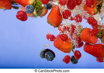 Fruit Background - Fruit splashing in water background -...