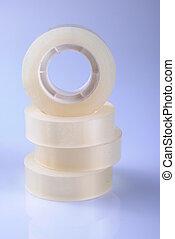 Transparent scotch tape rolls in a stack