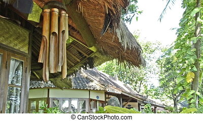 bamboo wind chime at a bungalow in indonesia in wind