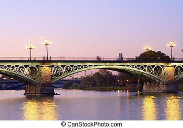 Triana bridge over the river Guadalquivir, Sevilla,...