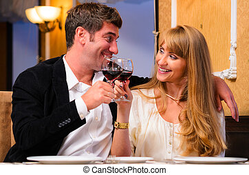 couple is sitting at restaurant