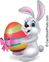 Cute rabbit cartoon holding easter - Vector illustration of...