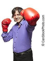 Asian man wearing boxing gloves smiling