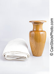 Wooden jug of water and white towel