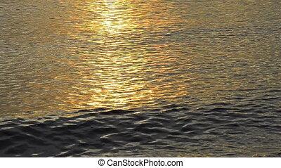 lights of sunrise over an ocean
