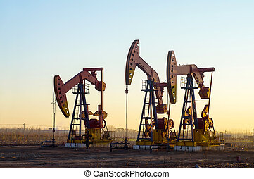 Pumpjack - Work of oil pump jack on a oil field. Oil and gas...
