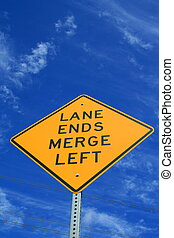 Lane Ends Road Sign - Lane ends road sign over blue sky