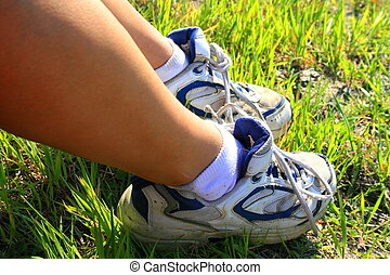 Sneakers - Close up of womans feet with sneakers on