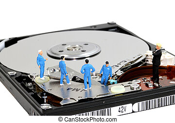 Hard disk - Group of engineers and mechanics maintain hard...