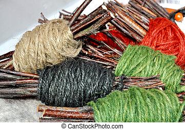 Yarn skeins - Handmade yarn skeins in a bundle with twigs as...