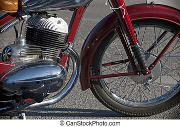 Side view of a veteran motorbike - Side view of a red...