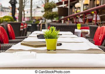 Empty table - street restaurant in Brugge, Belgium. -...