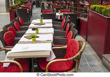 Outdoor restaurant in old town of Brugge - Belgium. - Tables...