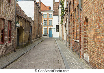 Narrow street old town of Brugge - Belgium. - Traditional...