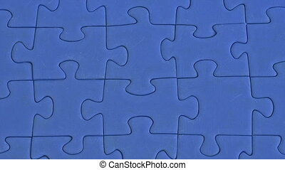 jigsaw of blue pieces - building a jigsaw of blue pieces